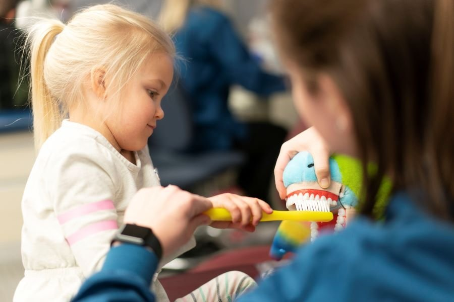 Teeth brushing lesson Little Apple Pediatric Dentistry